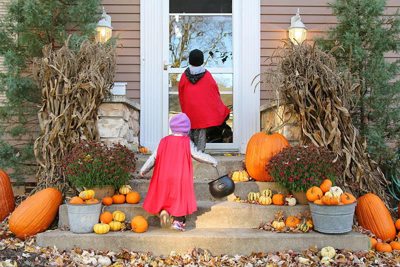 children in costumes going trick or treating