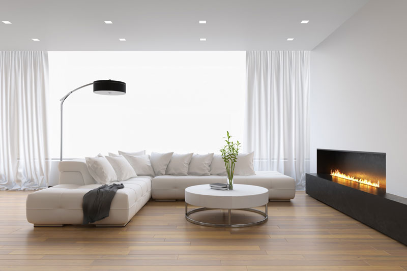 interior of chic and modern apartment with a sofa and electric fireplace